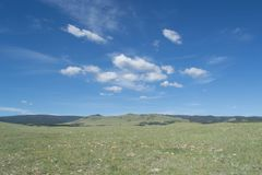 Large expanse of Wyoming prairie. A large, open expanse of the desolate Wyoming prairie, Great Plains, Laramie, blue sky, white clouds royalty free stock photography