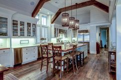 Free Large Expensive Chefs Kitchen In Luxury Home With Rough Hewn Wood And White Cabinets Royalty Free Stock Photos - 166537288