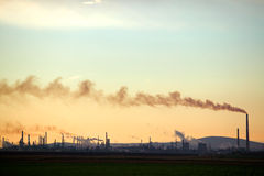 Large Factory. A large oil factory, liberating lots of toxic smoke Stock Photo