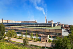 Large factory with smoking chimneys. Stock Photography