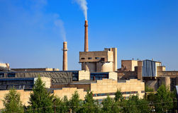 Large factory with smoking chimneys Stock Photos