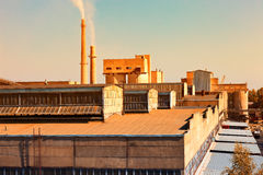 Large factory with smoking chimneys Stock Photography