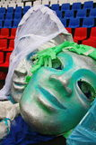 Large fake masks for the show open mass sports festival. In the background is painted in the colors of the Russian flag (tricolor - blue, red, white) seats at royalty free stock image