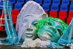 Large fake masks for the show open mass sports festival. In the background is painted in the colors of the Russian flag (tricolor - blue, red, white) seats at royalty free stock photos