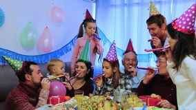 Large family celebrating children's birthday. Large family happy to celebrate children's birthday during dinner stock video footage