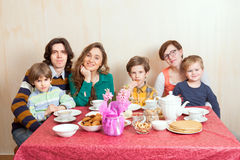 The large family at the dinner-table. With crepes and cookies Stock Images
