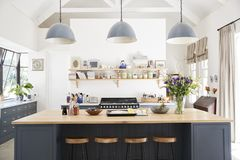 Large family kitchen in period conversion house, straight on royalty free stock photos