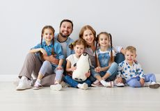 Large family mother father and children sons and daughters on white background stock images