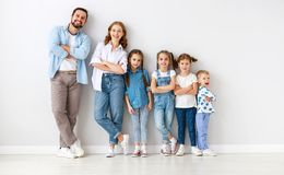 Large family mother father and children sons and daughters on white background royalty free stock photo