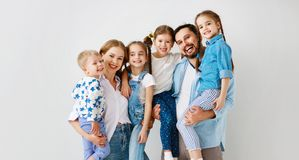 Large family mother father and children sons and daughters on white background stock photo