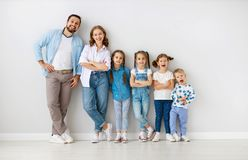 Large family mother father and children sons and daughters on white background royalty free stock photography