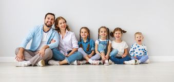 Large family mother father and children sons and daughters on white background stock photography