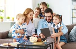 Large family mother, father and children with tablet computer at home stock photography