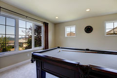 Large family room with pool table and tv. Royalty Free Stock Photography