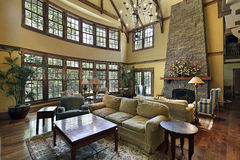 Large family room with stone fireplace Royalty Free Stock Photo