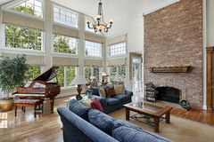 Large family room with two story windows Stock Photography