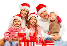 Large family in Santa hat with presents. Happy family sit together in large group with presents wearing Santa hat stock photos