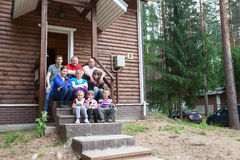 Large family sitting on the house porch together Stock Image