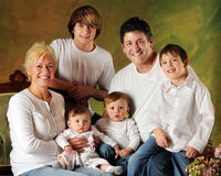 Large Family with Sons. A family portrait composed of Mom, Dad and four sons -- a baby, preschooler, elementary boy and young teen royalty free stock photo