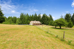 Large farm field with empty horse barn. During summer in Olympia, Washigton state stock image