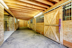 Large farm horse stable barn. Stock Photos