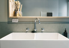 Large farmhouse style basin in vintage styled Australian home Stock Photo