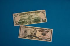 Large Fat Money Roll Isolated on a blue Background royalty free stock photos
