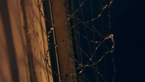 Large fence with barbed wire in the night stock video