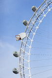 Large Ferris Wheel with a large basketball board and hoop attached  Stock Photography