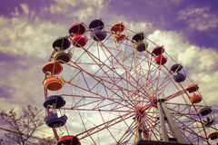 A large Ferris wheel in the park against the blue sky, a place for entertainment and recreation Stock Photography