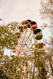 A large Ferris wheel in the park against the blue sky, a place for entertainment and recreation Stock Image
