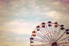 A large Ferris wheel in the park against the blue sky, a place for entertainment and recreation Royalty Free Stock Images
