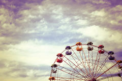 A large Ferris wheel in the park against the blue sky, a place for entertainment and recreation Royalty Free Stock Image