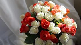 A large festive bouquet of roses stands near the window. HD 1920x1080 stock video