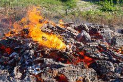 A large fire burning in the open. royalty free stock photos