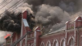 A large fire in a historic building in Kirov, Russia. Large fire in a historic building firefighters extinguish the fire with water hoses from the stairs stock video