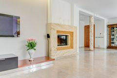 Large fireplace in posh villa Stock Images