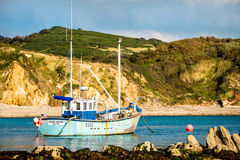 Large Fishing Boat Moored in a Bay. A large fishing boat, trawler, moored in the still waters of a secluded bay Royalty Free Stock Photos