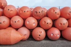 Large fishing buoys for networks in the sea. Dried on dock. Stock Images