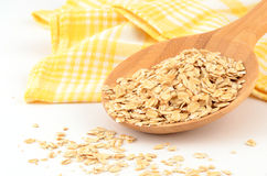 Large flake oats. Large flake whole grain oats in bamboo spoon Royalty Free Stock Image