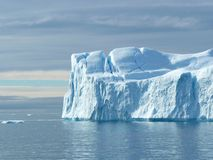 Large Flat Ended Iceberg 2. Big blue iceberg looks more like a white cliff. In the seas near Greenland Stock Photos