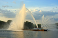 Large floating fountain. In the middle of artificial reservoirs in the city park stock image