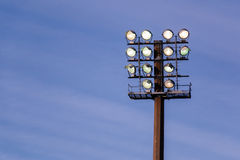 Large floodlight stand against the blue sky Royalty Free Stock Photography