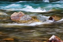 Large flow of the river. Water of the mountain river and a large stone Royalty Free Stock Images