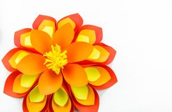 A large flower made of paper orange-red yellow colors