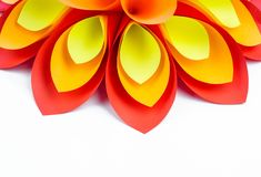 A large flower made of paper orange-red yellow colors stock photography