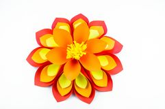 A large flower made of paper orange-red yellow colors stock image