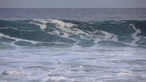 Large foamy waves in the Indian Ocean. Maldives video partial blur. Horizontal stock video footage