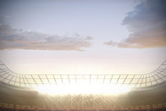 Large football stadium with spotlights Stock Photography