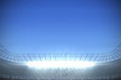 Large football stadium with spotlights under bright blue Royalty Free Stock Image